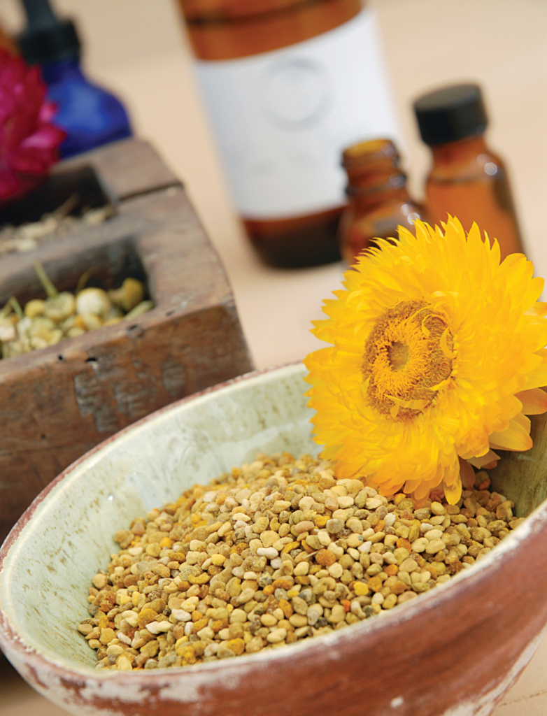 Whole Bee Pollen with other herbalist's items.
